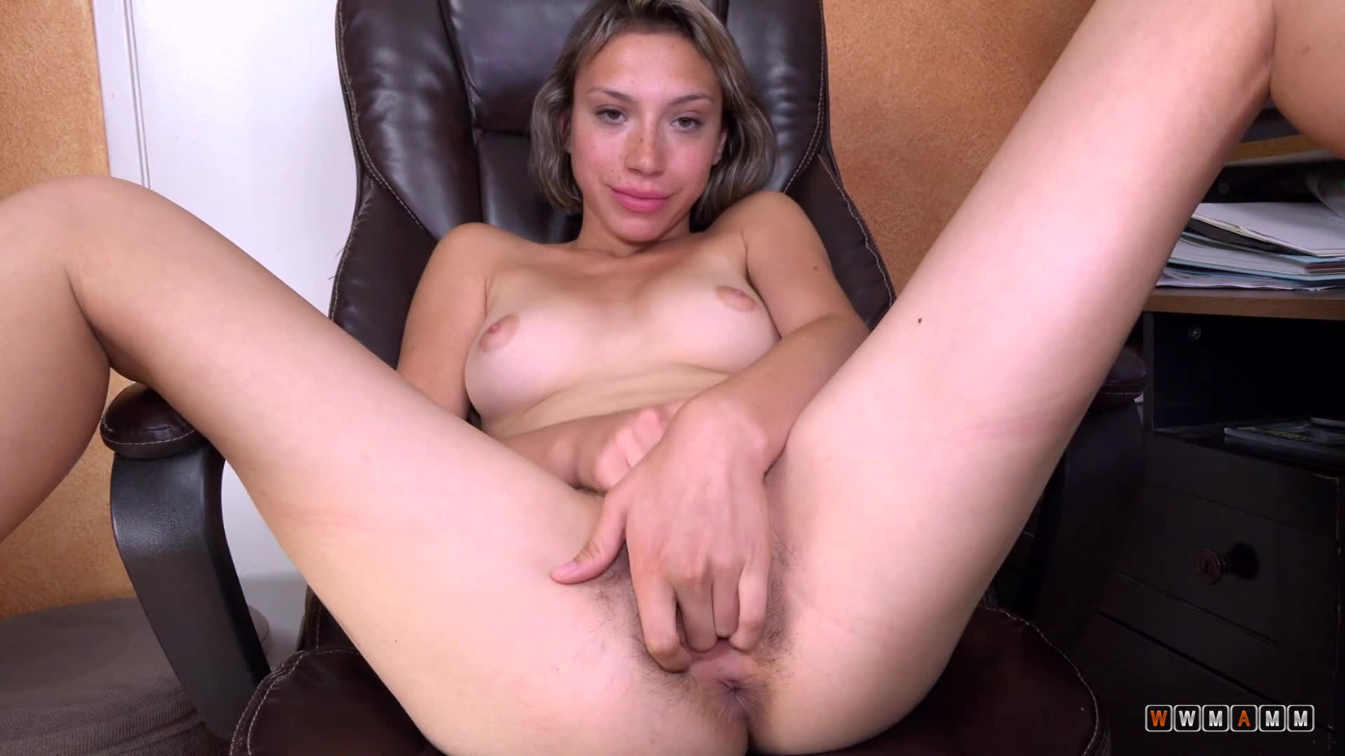 Amber Faye Gets Horny While Watching Lesbian Porn In The Office